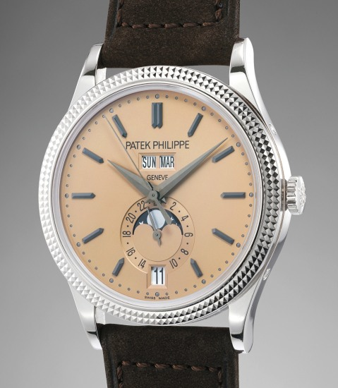 An extremely rare and attractive limited edition white gold annual calendar wristwatch with rose dial, black oxidized numerals, hobnail bezel, certificate of origin, attestation paper and presentation box, produced to mark the 5th Anniversary of Patek Philippe's entry into China and the inauguration of its Boutique in Shanghai