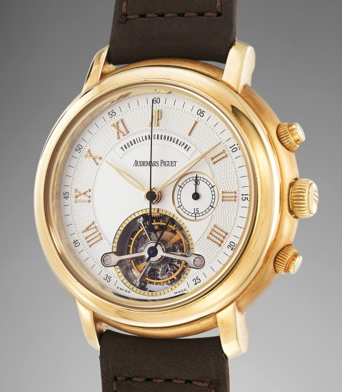 A highly rare and attractive yellow gold chronograph wristwatch with tourbillon, original certificate and presentation box