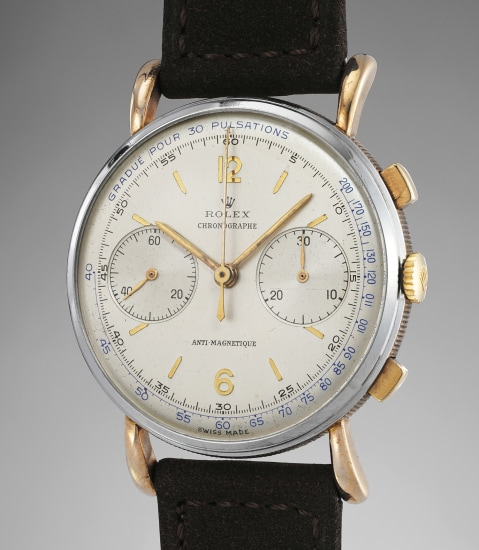 A rare and elegant stainless steel and pink gold chronograph wristwatch with pulsations dial and coin-edged caseband
