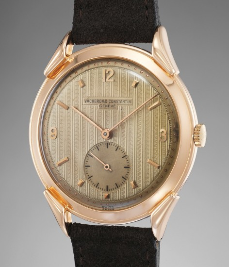 An attractive and rare oversized pink gold wristwatch with guilloché dial