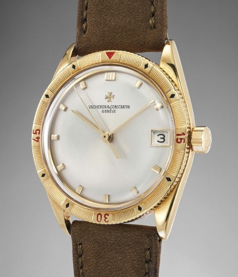 A rare and attractive yellow gold wristwatch with center seconds, date and rotating bezel