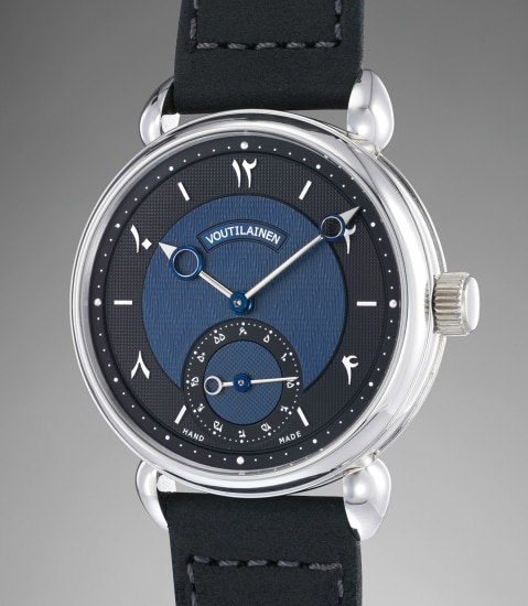 A very fine and rare platinum wristwatch with blue/black guilloché dial and Persian numerals with additional silver dial