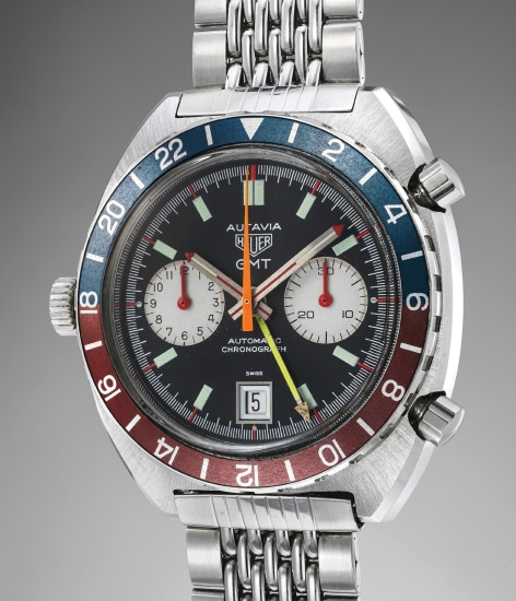 A fine and rare stainless steel chronograph wristwatch with date, dual time zone indication and bracelet