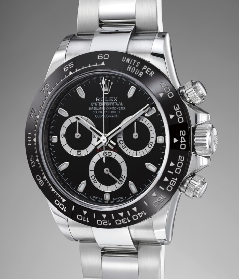 A rare and attractive stainless steel chronograph wristwatch with black dial, bracelet, guarantee and presentation box
