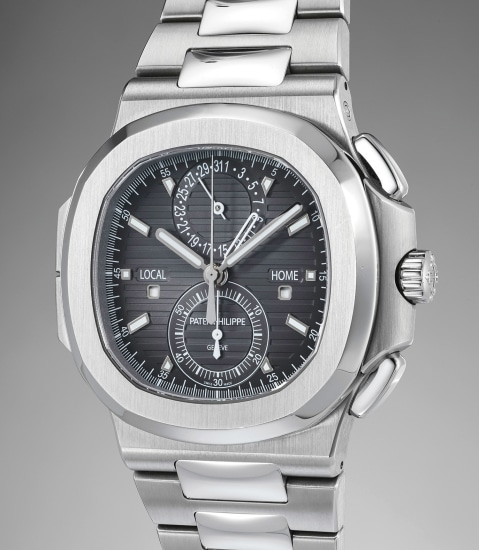 A rare and attractive stainless steel dual time flyback chronograph wristwatch with date, bracelet, original certificate, presentation box and outer packaging