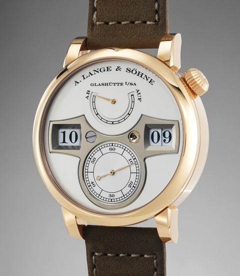 A very attractive pink gold wristwatch with digital jumping minutes and hours, box and guarantee