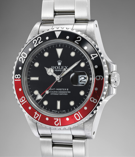 A highly rare, attractive and well-preserved stainless steel dual time wristwatch with center seconds, date, bracelet, guarantee and presentation box