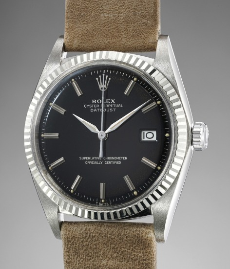 A very elegant and rare white gold automatic wristwatch with center seconds, date and black glossy luminous dial