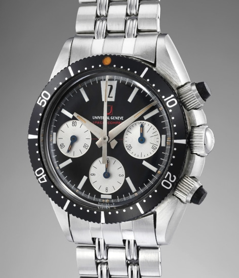 A very rare and attractive stainless steel chronograph wristwatch with black dial and silver registers, rubber chronograph pushers, red chronograph hand and bracelet