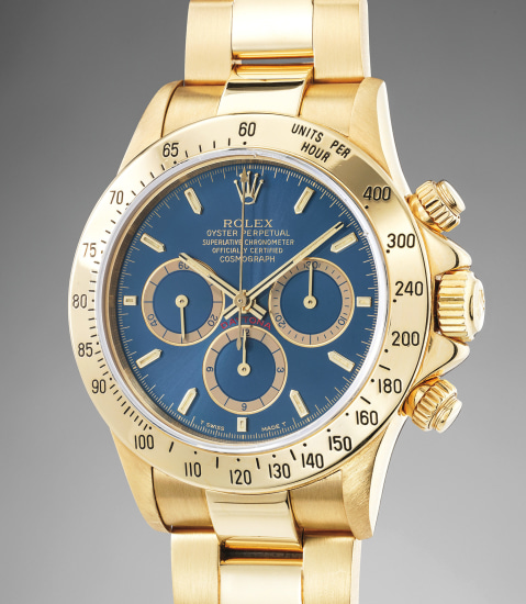 An extremely rare and highly attractive yellow gold chronograph wristwatch with blue dial and bracelet