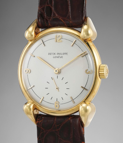A rare and attractive yellow gold wristwatch with fancy lugs and two-tone dial