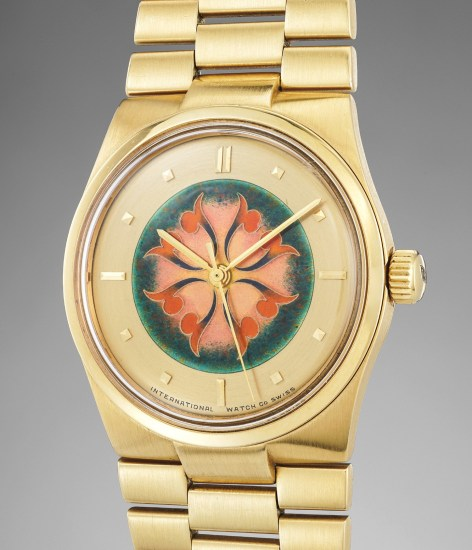 A highly rare and attractive yellow gold wristwatch with enamel dial and bracelet
