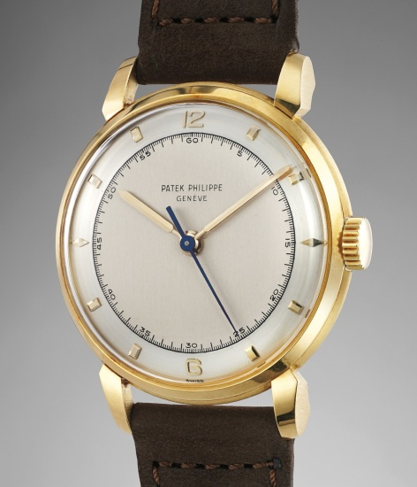 An exceptionally well-preserved, rare and large yellow gold wristwatch with sweep center seconds and two-tone dial