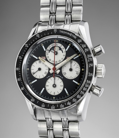 A very attractive stainless steel triple calendar wristwatch with moonphases, tachymeter scale, box and original guarantee