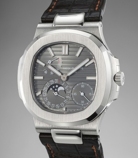A very fine white gold wristwatch with date, power reserve indication, moonphases, certificate and presentation box