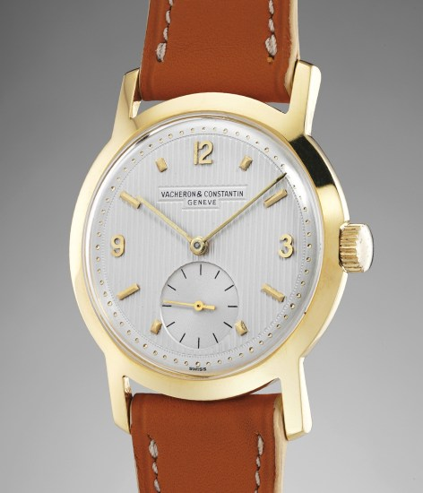 An attractive and fine yellow gold wristwatch with guilloché dial