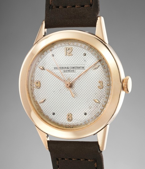 A distinguished and unusual pink gold wristwatch with center seconds and guilloché dial
