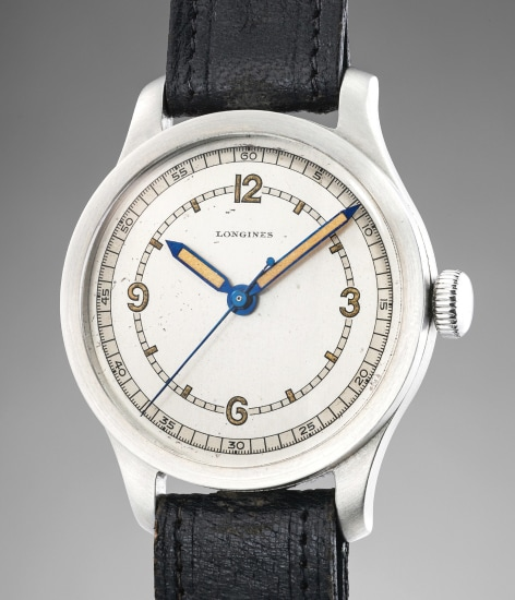 A highly rare and attractive stainless steel wristwatch with two-tone dial, center seconds, luminous markers and hands