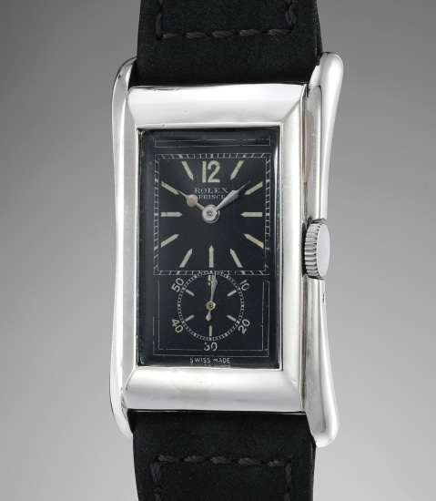 An extremely rare and attractive platinum rectangular doctor's wristwatch with black dial and flared lugs