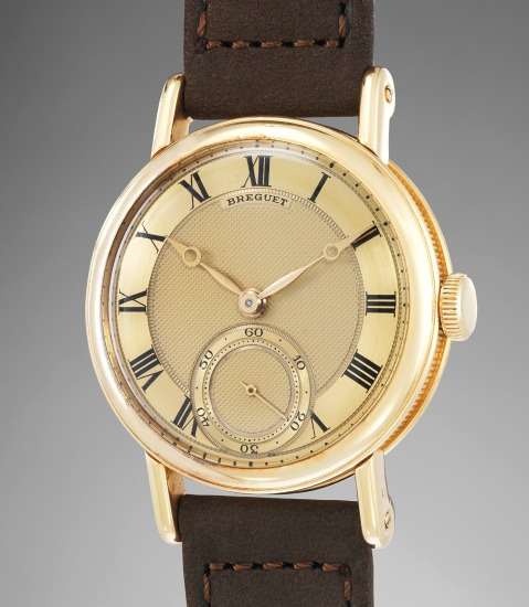 A fine, very rare, and attractive yellow gold wristwatch with gold guilloché dial