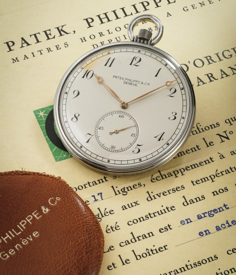 A very elegant stainless steel open face pocket watch with original certificate, invoice and pouch