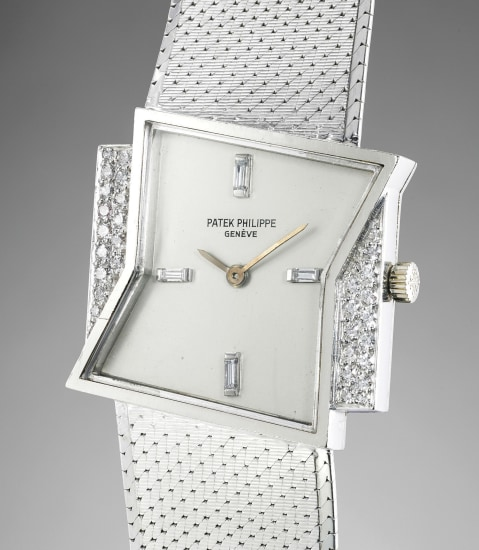 A rare and attractive white gold and diamond-set asymmetric wristwatch with bracelet