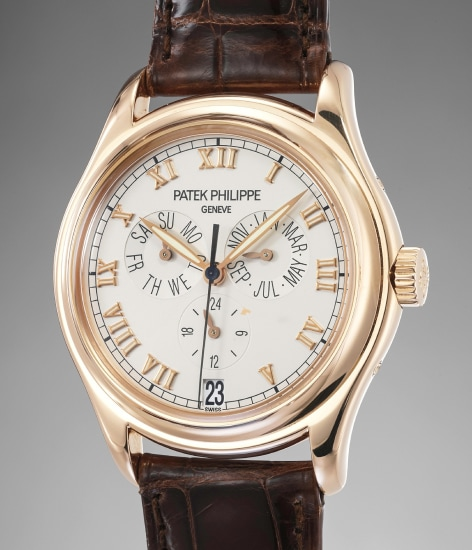 A rare and attractive pink gold annual calendar wristwatch with original certificate and presentation box