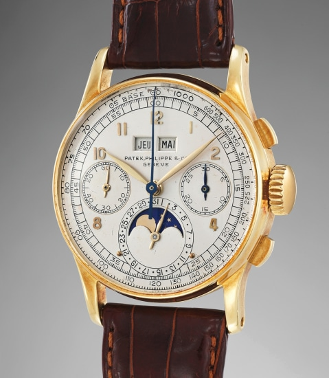 An extremely rare and very well-preserved yellow gold perpetual calendar chronograph wristwatch with moonphases