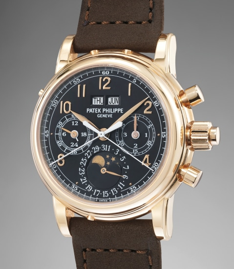 An extremely fine and exceedingly rare pink gold perpetual calendar split seconds chronograph wristwatch with moon phases, 24 hours, leap year indicator, black dial, original certificate, additional caseback and fitted presentation box