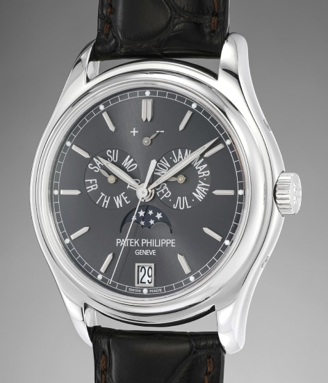 A fine and rare platinum annual calendar wristwatch with center seconds, moonphases, power reserve indication, original certificate and presentation box