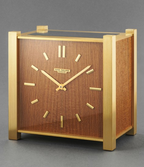 A highly rare and attractive squared-shaped gilt brass and teak desk clock with solar panel