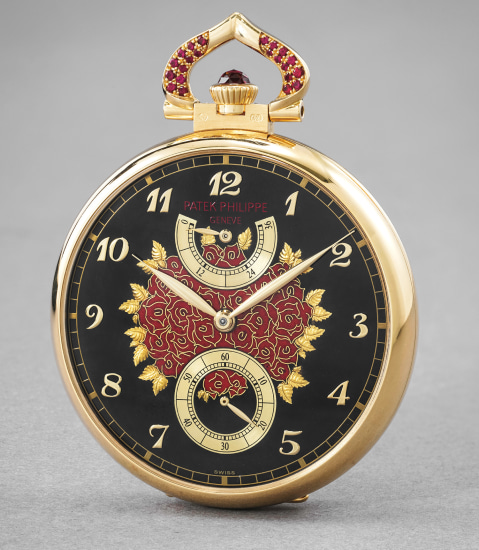 A unique, impressive and highly attractive yellow gold, paillonné enamel and ruby-set open face watch with power reserve depicting roses, original certificate and fitted presentation box