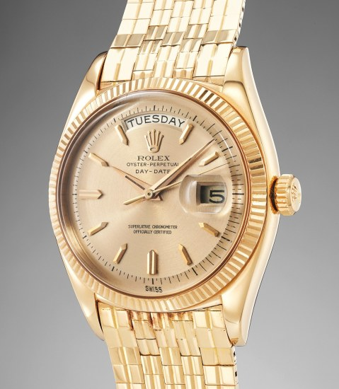 A very rare and impressive pink gold wristwatch with center seconds, day, date and brick link bracelet