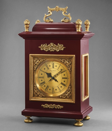 An interesting and unsusual wood and gilt metal quartz table clock