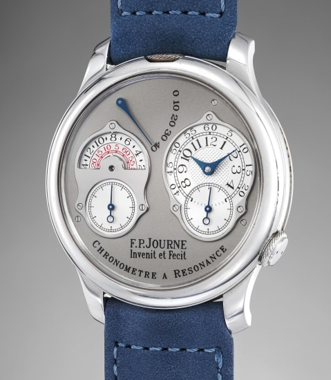 A fine and rare platinum dual time wristwatch with double escapement, original guarantee and presentation box