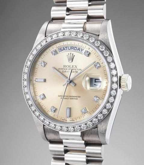 A highly attractive white gold and diamond-set calendar wristwatch with center seconds, bracelet, hang tags and guarantee