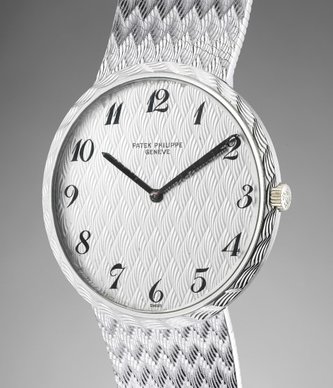 A highly rare and attractive white gold bracelet watch with Breguet numerals and textured dial