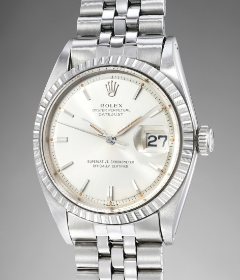 A fine, elegant and supremely well-preserved stainless steel wristwatch with center seconds, date, bracelet, Guarantee and box