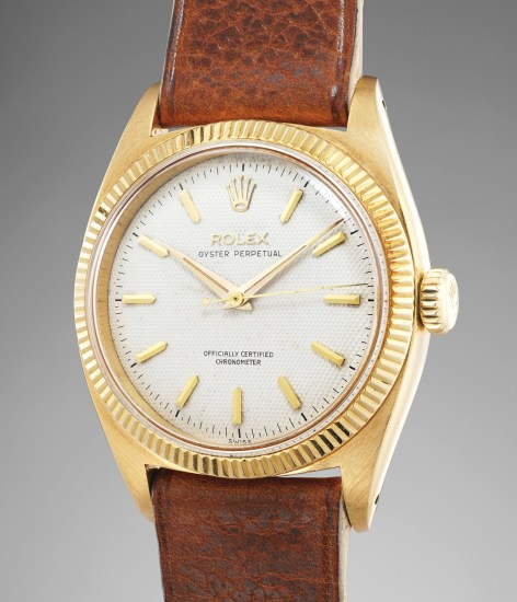 A very rare and very well-preserved yellow gold wristwatch with center seconds and honeycomb dial