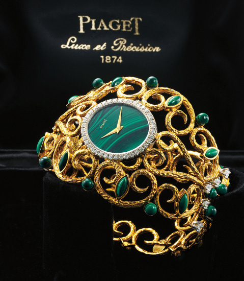 An incredibly attractive lady's yellow gold, malachite and diamond-set bangle watch with presentation box