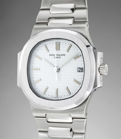 An extremely rare and attractive white gold wristwatch with center seconds, date, bracelet and box