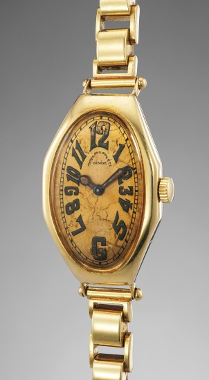 An early, highly rare and attractive yellow gold wristwatch with luminous numerals, hands and bracelet