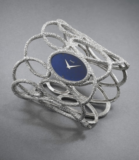 A superb white gold openwork textured bangle watch with lapis lazuli dial