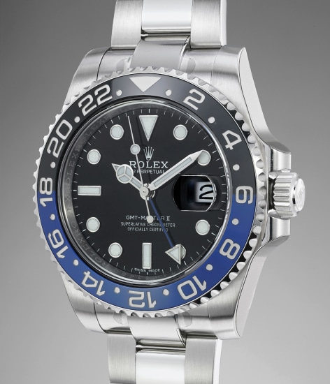A fine, attractive and mint-condition stainless steel dual time automatic wristwatch with center seconds, date, black and blue ceramic bezel, bracelet, Guarantee and box
