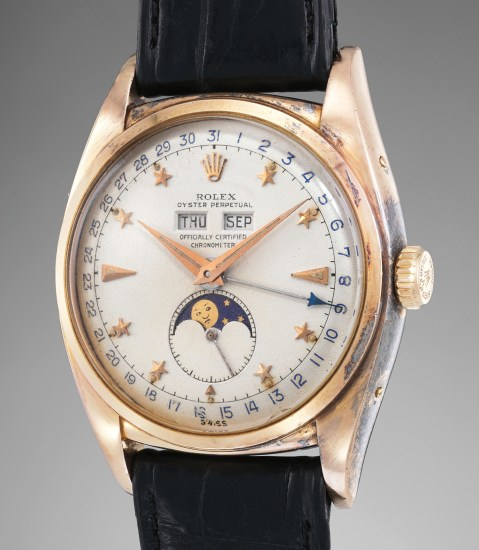 An incredibly rare and exceptionally well-preserved pink gold triple calendar wristwatch with star-set numerals and moonphases
