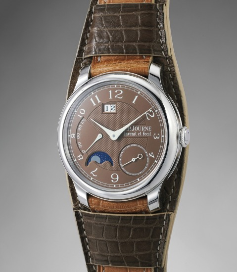 A very attractive platinum wristwatch with brown dial,  oversized date, power reserve and moonphases