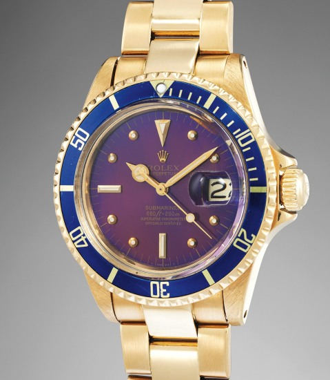 "A fine and very attractive yellow gold diver's wristwatch with date, blue bezel, purple ""tropical"" dial, bracelet and original Guarantee"