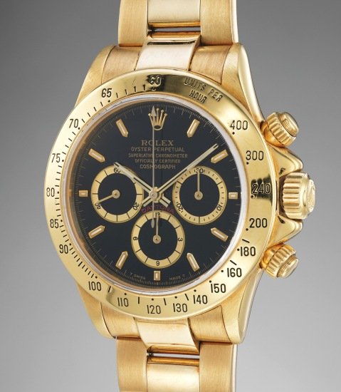 """A fine and attractive yellow gold chronograph wristwatch with """"inverted 6"""" black dial, bracelet, additional """"inverted 6"""" white dial with diamond-set numerals, punched guarantee box and service papers"""