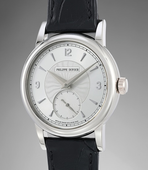 An extremely rare and fine white gold wristwatch with original certificate and presentation box