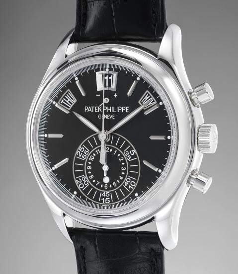 A rare and attractive platinum annual calendar chronograph wristwatch with black dial, original certificate and presentation box